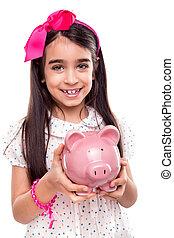 Girl holding a piggy bank