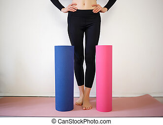 girl holding a pink and blue sports mat
