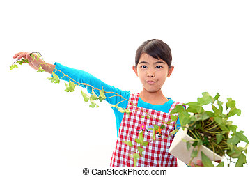 Girl holding a plant in her hand