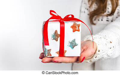 Girl holding a present box close up