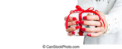 Girl holding a present box isolated on white