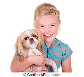 Girl holding a shih tzu dog - Girl holding her pet dog shih...