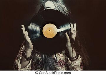 Girl holding a vinyl record