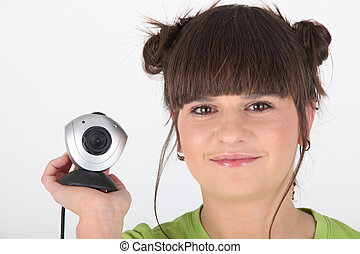 girl holding a web cam