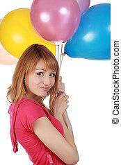 girl holding air balloon