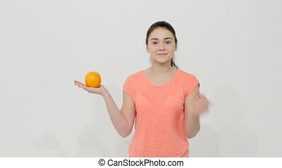 Girl Holding an Orange and an Apple