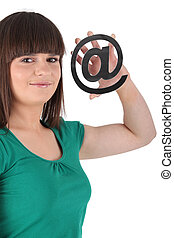 Girl holding an @ sign