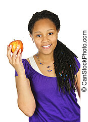 Girl holding apple - Isolated portrait of black teenage girl...