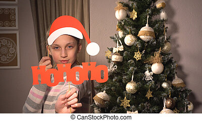 Girl holding banners with Santa's attributes - Nice girl in ...