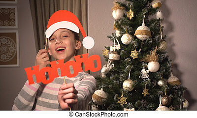 Girl holding banners with Santa's attributes - Smiling girl ...