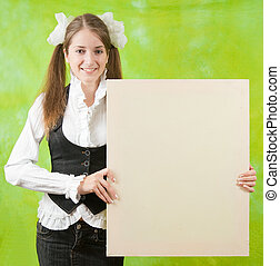 girl holding blank canvas - long-haired girl in school...
