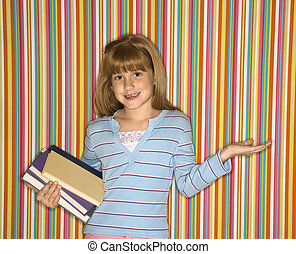 Girl holding books.