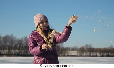 Girl holding brown cattail - Young girl let the wind cattail...