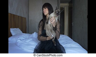 Girl holding cat in hands
