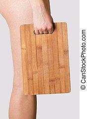 girl holding chopping board
