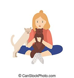Girl holding, cuddling and stroking her cats. Young woman ...