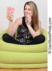 girl holding diary and smiling