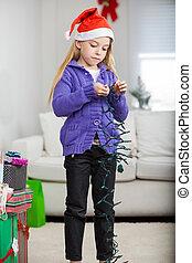 Girl Holding Fairy Lights During Christmas
