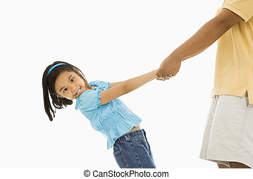 Girl holding father\'s hands.