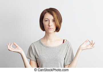 Girl holding finger together, position for meditation from yoga. Eyes opened. Trying to calm down.
