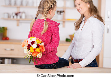 Girl Holding Flowers Behind Her Back By Mother - Little girl...