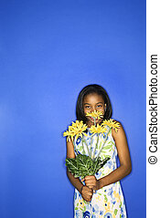 Girl holding flowers.