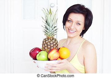 Girl holding fruit