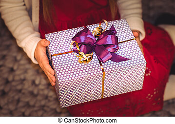 Girl holding gift box