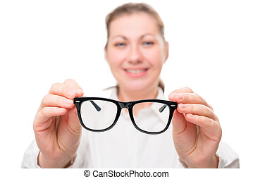 girl holding glasses, glasses in focus on a white background