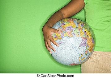 Girl holding globe.