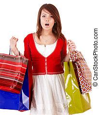 Girl holding group shopping bag.