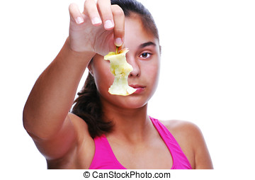 Girl Holding Half Eaten Apple bu its stem in Front of Her...
