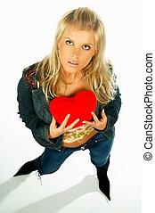 girl holding heart - Blonde sexy girl holding a red velvet...