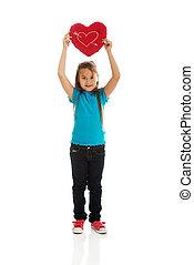 Girl holding heart pillow - Young girl holding heart pillow