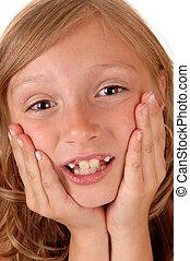 Girl holding her face.