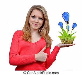girl holding in hand eco  bulbs