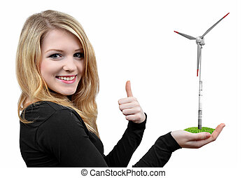 Girl holding in hand wind turbine