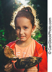 girl holding in hands the big mushrooms
