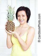 girl holding pineapple