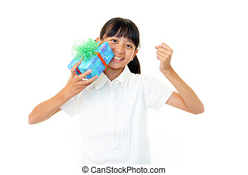 Girl holding present in hand