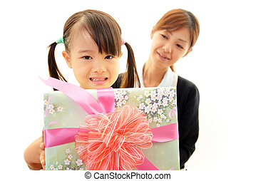 Girl holding present in hands
