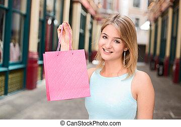 girl holding shopping bag