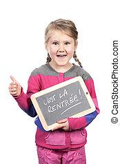 girl holding slate