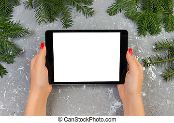 girl holding tablet technology in home, person holding computer on background Christmas decoration, female hands texting, mockup templates