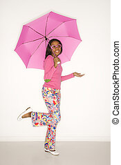 Girl holding umbrella.