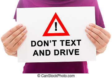 Girl holding white paper sheet with text Don't text and drive