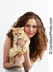 Girl holds a British cat