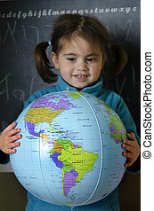 Girl holds a globe