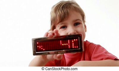 Girl holds an information LED display with words Happy...