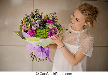 Girl holds bouquet of asters and lilac